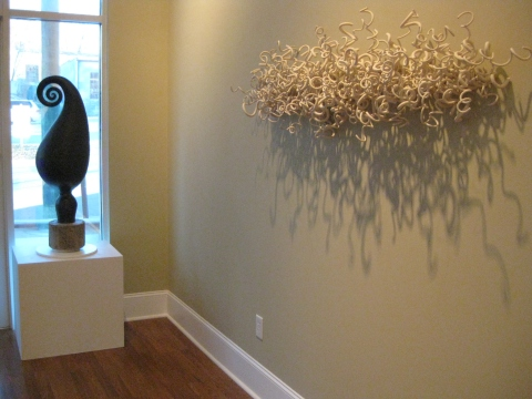 Work by Laurel Lukaszweski and Tamara Laird. Laurel's Morning Light piece is an installation, where she adds one coil at a time!